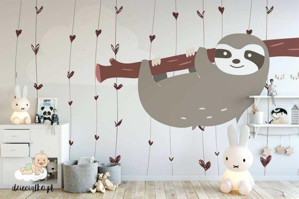 uroczy leniwiec wiszący na gałęzi - fototapeta dla dzieci