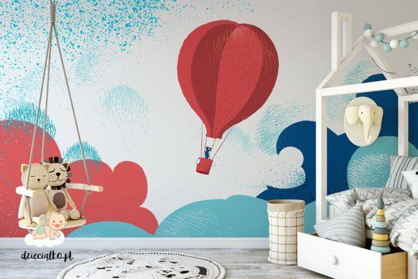 czerwony balon na kolorowym wzburzonym niebie - fototapeta dla dzieci