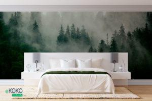 zielony jodłowy las na wzgórzu przykryty mgłą - fototapeta