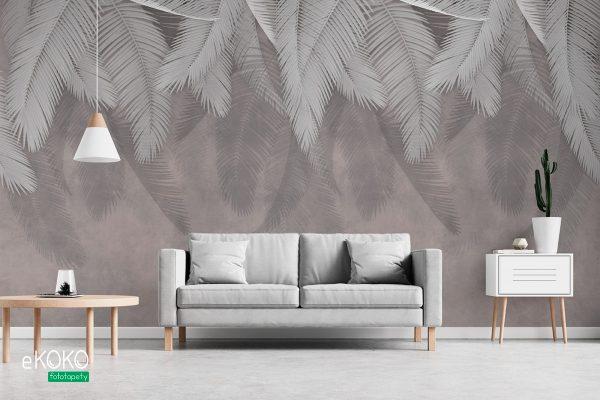zwisające szare palmowe liście na betonowym tle - fototapeta
