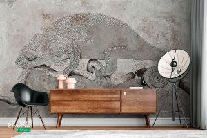 szary kameleon na gałęzi na betonowym tle – fototapeta
